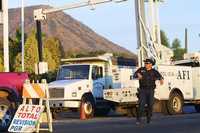 Foto: Elementos de la Agencia Federal de Investigación en uno de los retenes instalados en la entrada de Apatzingán