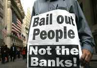 Los ciudadanos de Estados Unidos han comenzado a salir a las calles para manifestar su descontento por el manejo de la crisis. El cartel dice: Rescaten a la gente, no a los bancos