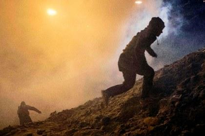 AFP ataque migrantes gases frontera.jpg